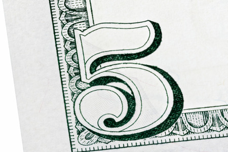five dollar bill: Detail of U.S. five dollar bill, isolated end stacked.