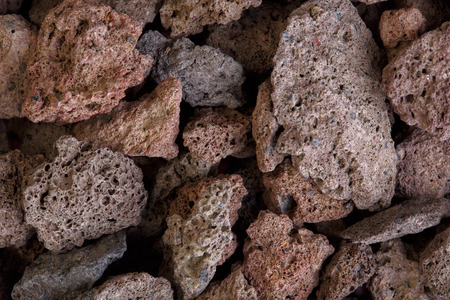 scoria: Macro photo of red volcanic lava stones. Stock Photo