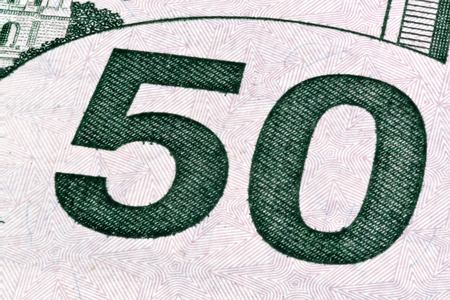 fifty dollar bill: Detail of U.S. fifty dollar bill, isolated end stacked.