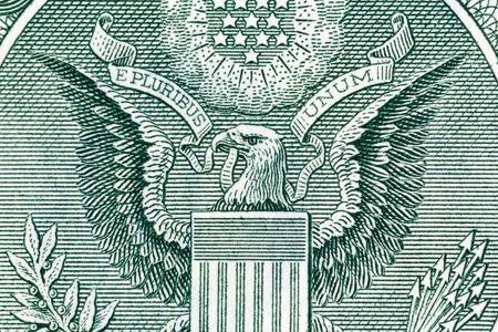 unum: Eagle on one U.S. dollar bill, close-up photo.