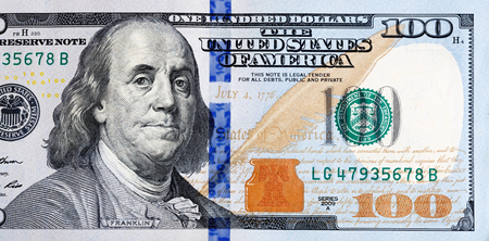 Macro shot of a new 100 dollar bill.