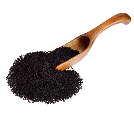 nigella seeds: Nigella or Black cumin in the wooden spoon, isolated on white background.