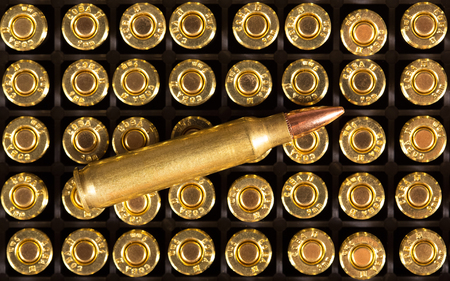 full jacket bullet: Ammunition cartridge on background. Stock Photo