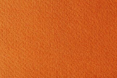 textured paper: Orange textured paper. Stock Photo