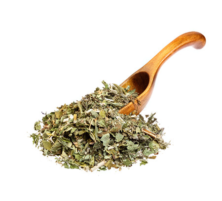 gunpowder tea: Dried mint on the wooden spoon.
