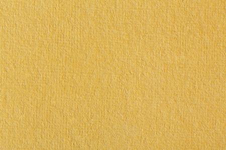 textured paper: Soft orange textured paper. Stock Photo