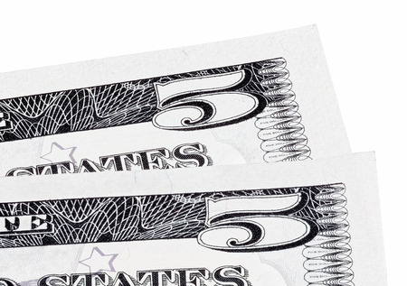 two us dollar: Detail macro photo of two U.S. five dollar banknotes, isolated on white end stacked.
