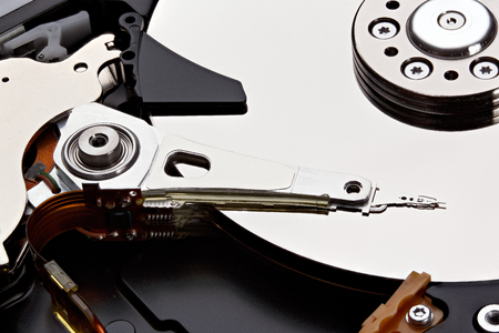 internals: Internals of a hard disk drive (HDD). Stacked photo.