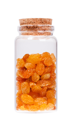 stopper: Raisins in a glass bottle with cork stopper, isolated on white. Stock Photo