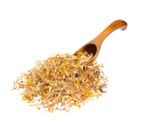 Arnica: Mountain arnica on the wooden spoon.