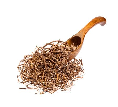 Valerian root on the wooden spoon.