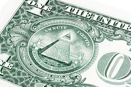 illuminati: U.S. one (1) dollar bill in a close-up photo. Shallow depth of field effect. Eye of Providence, all-seeing eye of God, Mason Illuminati Logo, Pyramid, Triangle. Great Seal. Stock Photo