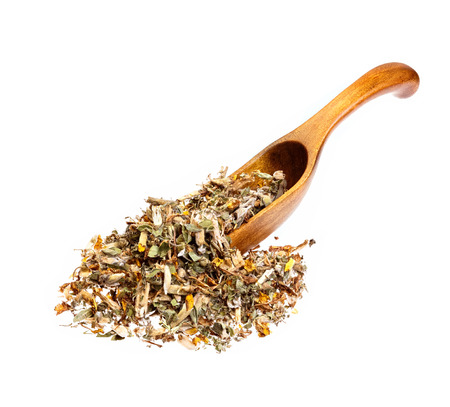 herba: Genistae herba for medical use on wooden spoon, isolated on white.