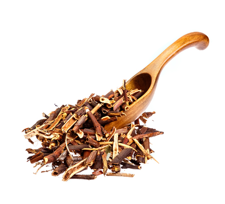 palustre: Dry Comarum on the wooden spoon. Stock Photo