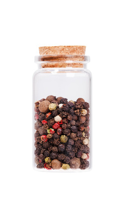 stopper: Mix of dried pepper in a glass bottle with cork stopper, isolated on white. Stock Photo