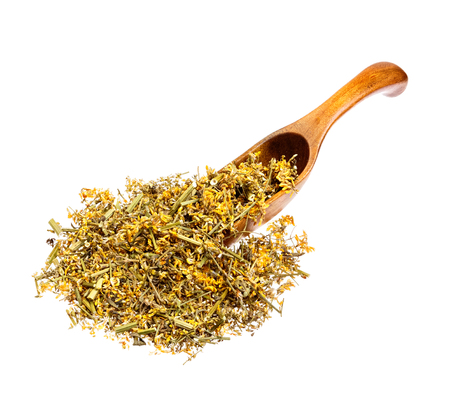 herba: Dried Melilotus officinalis (Yellow Sweet Clower) on the wooden spoon.