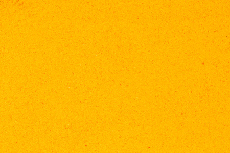 indian spice: Turmeric powder background, yellow grain abstract texture.