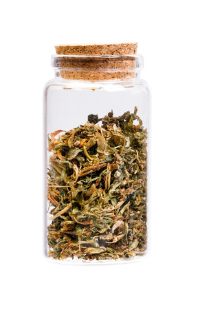 sativa: Dry Alfalfa (Medicago sativa) in a bottle with cork   for medical use. Stock Photo
