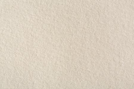 ベージュの用紙の背景のテクスチャです。