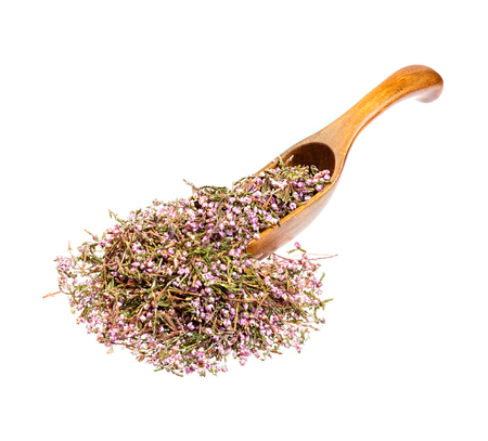 nontraditional: Heather blossom tea on the wooden spoon.