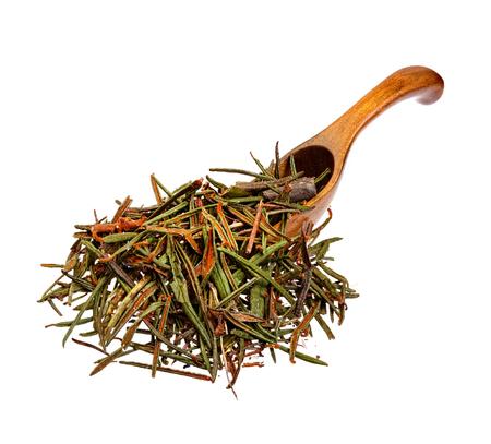 palustre: Marsh (Northern) Labrador Tea (Ledum palustre) on the wooden spoon.