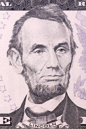 five dollar bill: Portrait of Abraham Lincoln on five U.S. dollar bill.