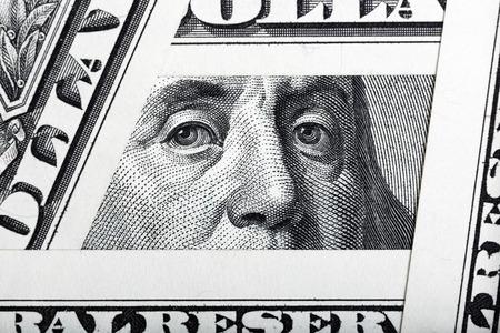 one hundred dollar bill: Benjamin Franklin on the one hundred dollar bill framed by one dollar banknotes.