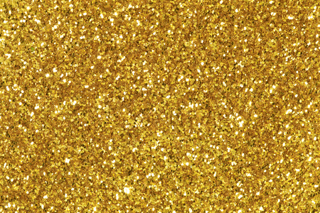 foil: Background filled with shiny gold glitter. Stock Photo