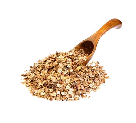 semen: Parsnip seeds on the wooden spoon. Stock Photo