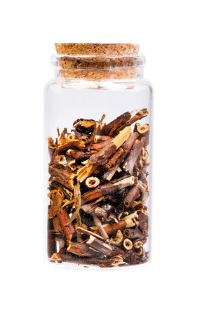 palustre: Dry Comarum in a bottle with cork for medical use. Stock Photo