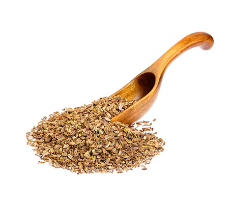 fennel seeds: Fennel seeds on wooden spoon.