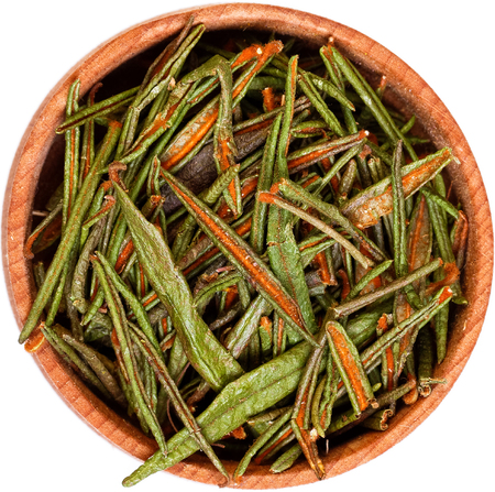 palustre: Marsh (Northern) Labrador Tea (Ledum palustre) in a small wooden bow isolated on white. Stock Photo