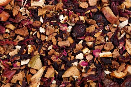 Tea fruity blend of hibiscus petals, orange peel, rose hips, apple, melon flavor. Stock Photo