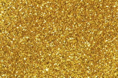 Tło wypełnione błyszczącą złotą brokatem.
