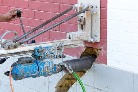 tool chuck: Concrete core drilling machine on a building construction site.