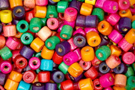 seed beads: Tiny colored wooden beads closeup.