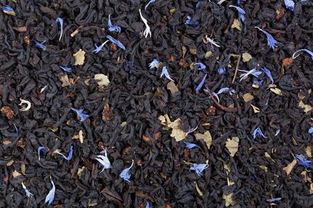 dried orange: Tea with dried orange and cornflower petals background. Stock Photo
