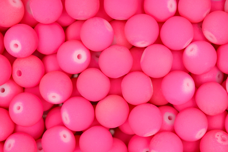 color balls: Small pink beads background. Stock Photo