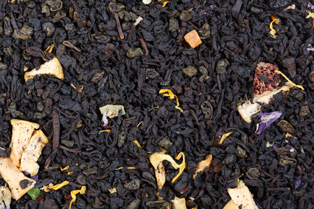 gunpowder: Mix of black Ceylon tea and green gunpowder tea with the addition of flower petals and pieces of fruit. Stock Photo