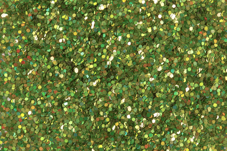 contrast: Green glitter texture. Low contrast photo.