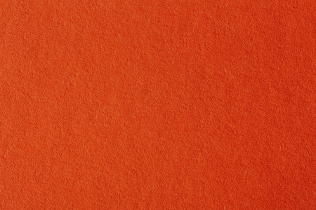 on the surface: Orange paper surface. Stock Photo