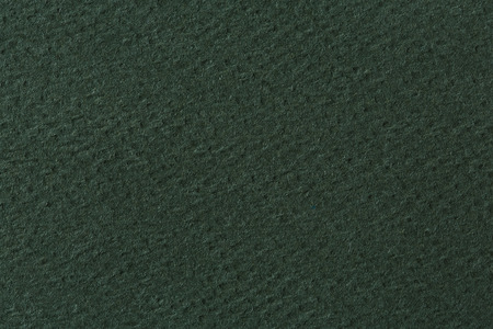 textured paper: Textured green paper. Stock Photo