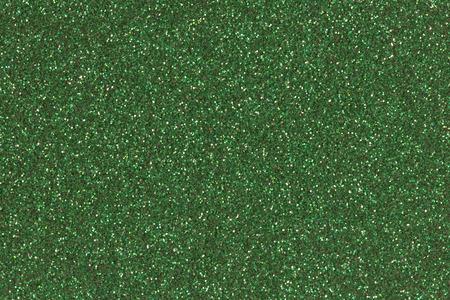 emerald: Emerald green glitter texture or background.