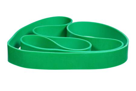 elasticidad: banda de la mu�eca de goma verde trenzado aislado en blanco.
