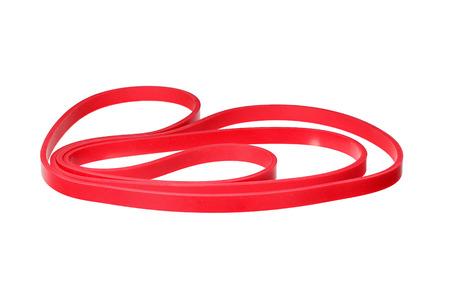 elasticity: banda de la muñeca de goma de color rojo trenzado aislado en blanco. Foto de archivo
