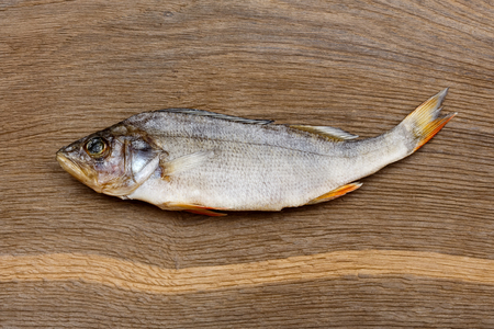 silver perch: Salty dry river fish (perch, bass) on a wooden impressive background.