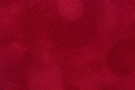 Closeup detail of aged red velvet texture background. High quality image.