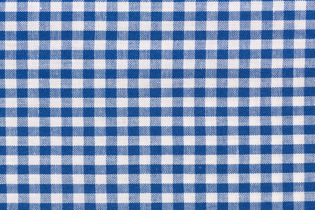 light blue lingerie: Close up of blue checkered rural tablecloth background.