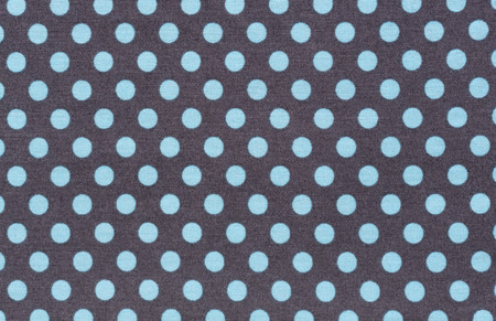 dark fiber: Black fabric with blue polka dots. Turquoise satin with white polka dots. Hi res Stock Photo