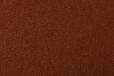 dark fiber: Background of dark brown felt. High resolution photo.
